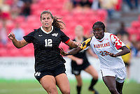 Katie Stengel (12) of Wake Forest looks for the ball as Shade Pratt (22) of Maryland defends during the game at Ludwig Field in College Park, MD.  Maryland defeated Wake Forest, 1-0.
