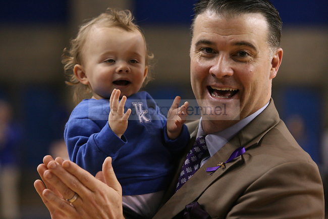 UK head coach Matthew Mitchell claps with his daughter Saylor at the end of UK v. Mississippi State game at Memorial Coliseum on Thursday, January 17, 2013 in Lexington, Ky.  Photo by Adam Pennavaria | Staff