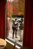 USA, Oregon, Ashland, friends gather outside of the Sesame Asian Kitchen restaurant, across the street from Lithia Park