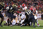 Reggie Gallaspy II (25) of the North Carolina State Wolfpack is stopped short of the goal line by Luke Masterson (12) of the Wake Forest Demon Deacons during second half action at BB&T Field on November 18, 2017 in Winston-Salem, North Carolina.  The Demon Deacons defeated the Wolfpack 30-24.  (Brian Westerholt/Sports On Film)
