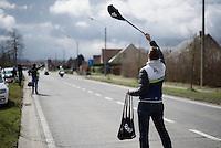 Orica-GreenEDGE soigneur Joachim Schoonacker (BEL) making himself visible ahead of the riders arriving in the feedzone<br /> <br /> 71st Dwars door Vlaanderen (1.HC)