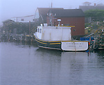 "Lunenburg County, Nova Scotia<br /> Fishing vessel ""A Proud Canadian II"" docked in the harbor of Blue Rocks village on foggy Lunenburg Bay"
