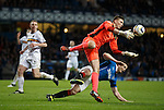 Dumbarton keeper Danny Rogers saves from Rangers striker Jon Daly