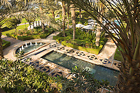 Dubai.  Moroccan style water garden at the Ritz Carlton Hotel at Jumeirah Beach..