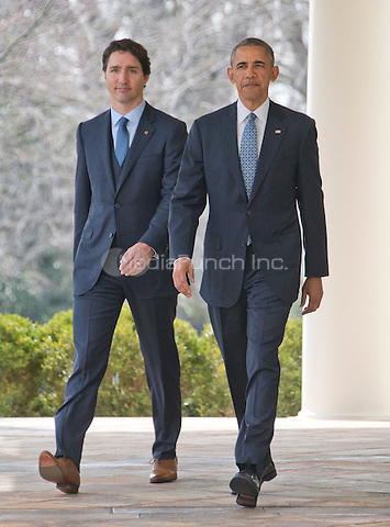 United States President Barack Obama, right, and Prime Minister Justin Trudeau of Canada, left, walk from the Oval Office to conduct a joint press conference in the Rose Garden of the White House in Washington, DC on Thursday, March 10, 2016. <br /> Credit: Ron Sachs / CNP/MediaPunch