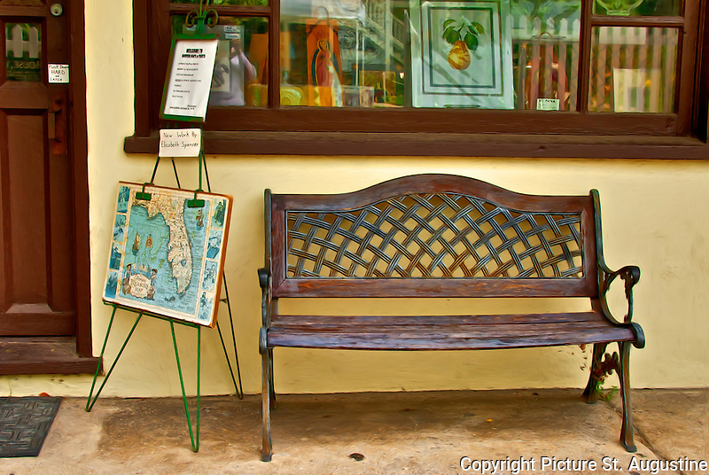 A bench sits under a shop window in downtown St. Augustine, Florida