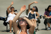 Chuck Beckley/ Daily News   Marissa Palumbo shields her eyes as she watches the New River Air show Saturday afternoon.