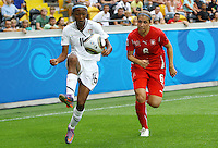 USA's Maya Hayes (L) and Selina Kuster of Switzerland during the FIFA U20 Women's World Cup at the Rudolf Harbig Stadium in Dresden, Germany on July 17th, 2010.