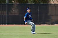 Los Angeles Dodgers left fielder Andy Pages (65) prepares to catch a fly ball during an Instructional League game against the Milwaukee Brewers at Maryvale Baseball Park on September 24, 2018 in Phoenix, Arizona. (Zachary Lucy/Four Seam Images)