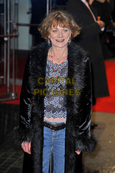 "Samantha Bond.The ""Run For Your Wife"" world film premiere, Odeon Leicester Square cinema, Leicester Square, London, England..February 5th, 2013.half length black fur coat jeans denim blue top floral print .CAP/MAR.© Martin Harris/Capital Pictures."