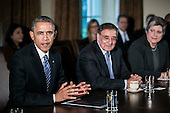 United States President Barack Obama, left, speaks as Secretary of Defense Leon E. Panetta, center, and Secretary of Homeland Security Janet A. Napolitano, right, listen at a cabinet meeting at the White House on Nov. 28, 2012 in Washington, D.C. The president met yesterday with small business owners and today with the chief executives of major corporations in ongoing talks about the looming fiscal cliff..Credit: T.J. Kirkpatrick / Pool via CNP
