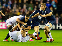 8th February 2020; Murrayfield Sadium, Edinburgh, Scotland; International Six Nations Rugby, Scotland versus England; Adam Hastings of Scotland  is tackled by Mako Vunipola of England