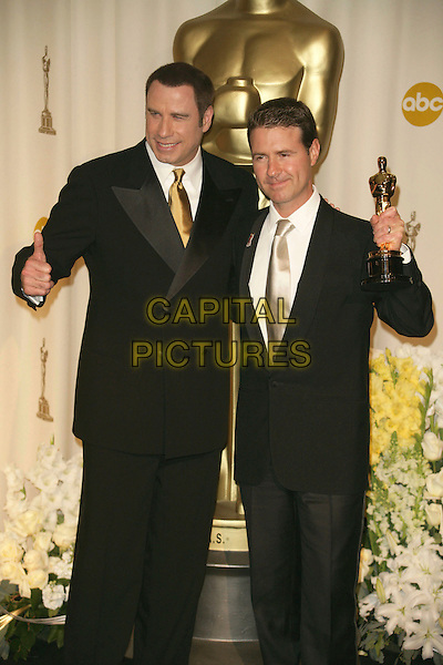 DION BEEBE & JOHN TRAVOLTA.The 78th Annual Academy Awards - Press Room, held at the Kodak Theatre, Los Angeles, California, USA, .5th March 2006..oscars half length holding oscar thumb up gesture.Ref: ADM/RE.www.capitalpictures.com.sales@capitalpictures.com.©Russ Elliot/AdMedia/Capital Pictures.