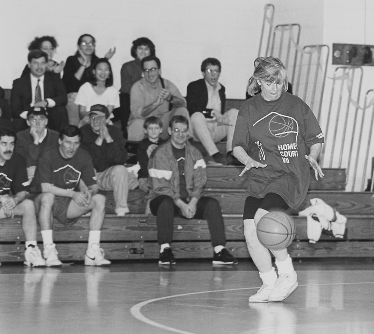 Rep. Lynn Woolsey, D-Calif., dribbles basketball down court as the Hills Angles Bench looks on. Home court basketball benefit, March 22, 1994. (Photo by Chris Martin/CQ Roll Call via Getty Images)
