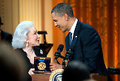 United States President Barack Obama presents Eunice David, the wife of musician Hal David, with a Gershwin Prize honoring her husbands work during a concert honoring him and fellow prize recipient Burt Bacharach, in the East Room at the White House in Washington on May 9, 2012.  .Credit: Kevin Dietsch / Pool via CNP