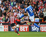 Jack O'Connell of Sheffield Utd clears despite Dean Moore of Peterborough Utd  during the League One match at Bramall Lane Stadium, Sheffield. Picture date: September 17th, 2016. Pic Simon Bellis/Sportimage