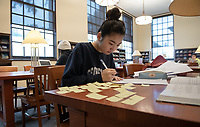 Sophia Yang '20 uses small notes as she studies for her organic chemistry final.<br /> Occidental College students study for finals and write papers during finals week in the Academic Commons/Mary Norton Clapp Library, Wednesday, May 8, 2019.<br /> (Photo by Marc Campos, Occidental College Photographer)