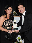 Catherine Donegan of Cagney's receives the award for Best Bar/Pub of the Year from James Cloney representing sponsor Diageo at the Business Excellence Awards in Earth Night Club at the Westcourt Hotel. Photo:Colin Bell/pressphotos.ie