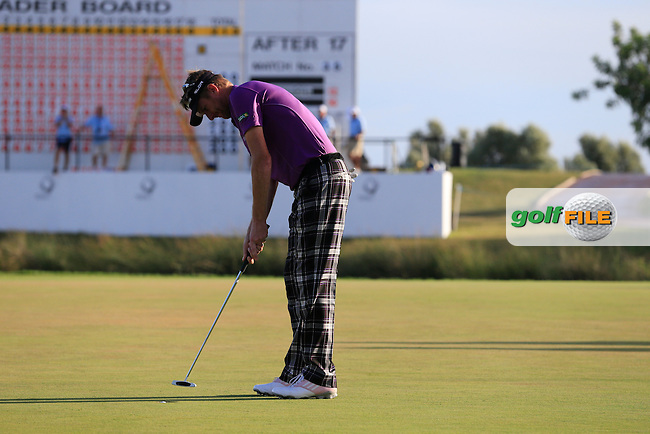 David Lynn (ENG) putts on the 18th green during Saturday's Round 3 of the 2013 Portugal Masters held at the Oceanico Victoria Golf Club. 12th October 2013.<br />