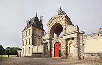Porte du Baptistere or Porte Dauphine, built 1565 by Primaticcio and enlarged in 1601-06 under King Henri IV, Chateau de Fontainebleau, France. The Palace of Fontainebleau is one of the largest French royal palaces and was begun in the early 16th century for Francois I. It was listed as a UNESCO World Heritage Site in 1981. Picture by Manuel Cohen