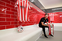 Lincoln City's assistant manager Nicky Cowley with the Emirates FA Cup in the changing room of Lincoln City's new Elite Performance Centre<br /> <br /> Photographer Chris Vaughan/CameraSport<br /> <br /> The official opening of Lincoln City's new Elite Performance Centre - Wednesday 7th November 2018 - Scampton, Lincolnshire<br /> <br /> World Copyright © 2018 CameraSport. All rights reserved. 43 Linden Ave. Countesthorpe. Leicester. England. LE8 5PG - Tel: +44 (0) 116 277 4147 - admin@camerasport.com - www.camerasport.com