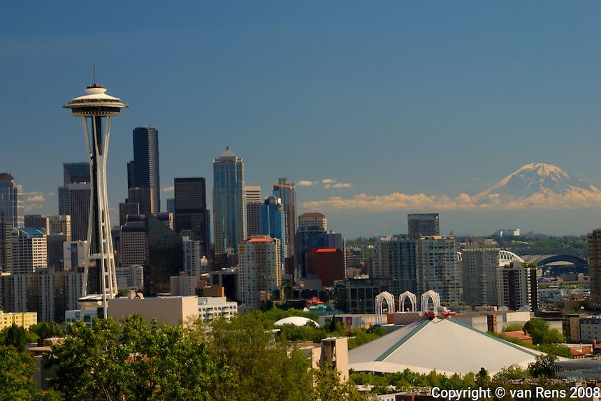 Seattle, WA vista from highland Par. Mt. Rainier floating in background.