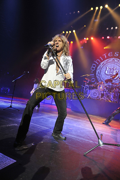 WHITESNAKE - David Coverdale.Whitesnake performing live at the Hammersmith Apollo, London, England..June 20th, 2011.stage concert live gig performance music full length white shirt microphone singing jeans denim black chest necklaces .CAP/MAR.© Martin Harris/Capital Pictures.