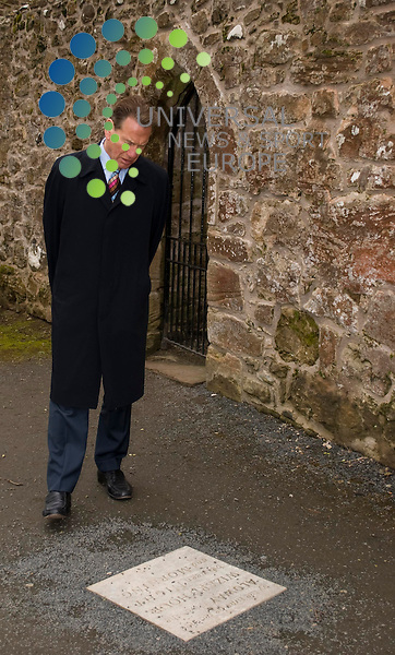 Michael Portillo and fellow Art Fund judges visit The Robert Burns Birthplace Museum in Alloway. The museum is in the running for a £100,000 prize which will be announced in London in June. Michael Portillo reads one of the exerts from a Burns poem while going round the ruin of Alloway Kirk .Picture: Thomas Smillie/Universal News And Sport (Europe) All pictures must be credited to www.unpixs.com. (0ffice) 0844 884 51 22.21 March 2011..