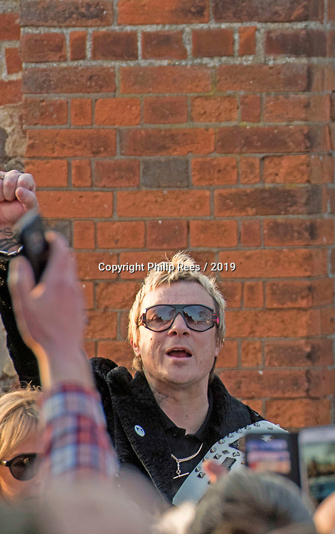 The  funeral of Prodigy singer Keith Flint at St Marys Church in Bocking,  Essex today. Laim Howlett of the Prodigy leaves the service and salutes the lined up fans.