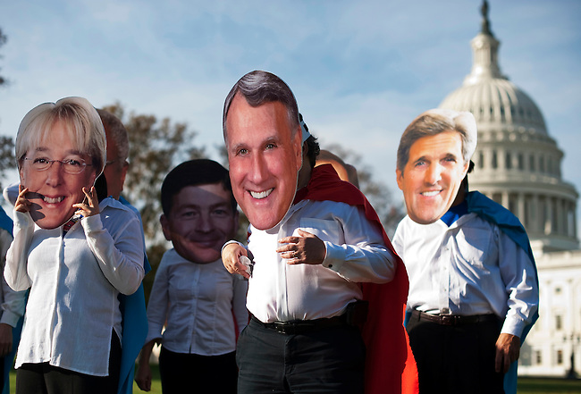 "Oxfam America activists put on their masks to stage a photo-op on the east side of the Capitol before the start of the Joint Select Committee on Deficit Reduction hearing on ""Discretionary Outlays, Security and Non-Security"" on Wednesday, Oct. 26, 2011. The activists wore giant masks featuring photos of Super Committee members, and wore Super Committee capes to ask if the committee members will be super heroes by defending the poor from budget cuts. (Photo By Bill Clark/CQ Roll Call)"