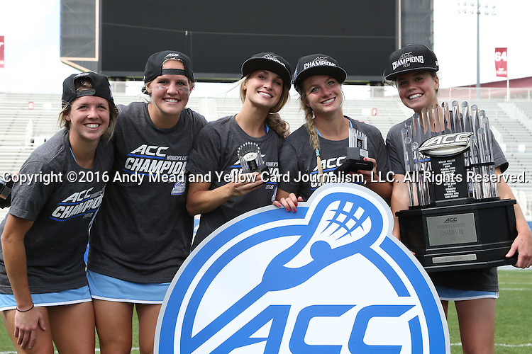 01 May 2016: UNC players pose with the championship trophy. The University of North Carolina Tar Heels played the Syracuse University Orange at Lane Stadium in Blacksburg, Virginia in the 2016 Atlantic Coast Conference Women's Lacrosse Tournament championship match. North Carolina won 15-14 in overtime.