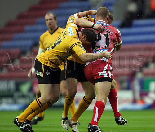 06.07.2011 Engage Super League Rugby from the DW Stadium. Wigan Warriors v Castleford Tigers. Lee Mossop is tackled by Stuart Jones.