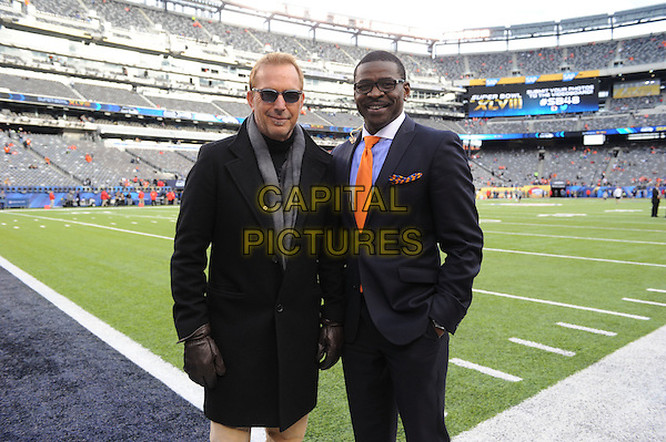 EAST RUTHERFORD, NJ - FEBRUARY 02: Kevin Costner and Michael Irvin attend Super Bowl XLVIII  at MetLife Stadium on February 2, 2014 in East Rutherford, NJ., USA.<br /> CAP/MPI/PGF<br /> &copy;PGFMicelotta/MediaPunch/Capital Pictures