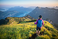 Hiking on the Rophaien ridgeline at sunrise, with a view to Vierwäldstattersee, Switzerland