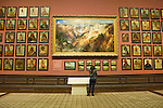 Visitor at George Catlin exhibit, interior, Renwick Gallery, a branch of the Smithsonian American Art Museum, Washington DC, USA, (not released), editorial only.
