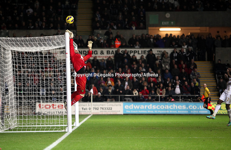 Barclays Premier League, Swansea City (White) V Norwich City (black) Liberty Stadium, Swansea, 08/12/12<br /> Pictured: Mark Bunn the Norwich keeper just manages to tip this one over the bar.<br /> Picture by: Ben Wyeth / Athena <br /> Athena Picture Agency<br /> info@athena-pictures.com