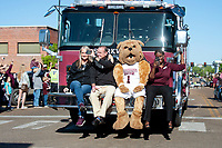 Women's Basketball team arriving to downtown celebration on fire trucks.<br />  (photo by Beth Wynn / &copy; Mississippi State University)