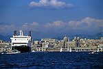 Large ferry boat entering the Marseille port, with the Marseille Cathedral in the background, Marseille, France.