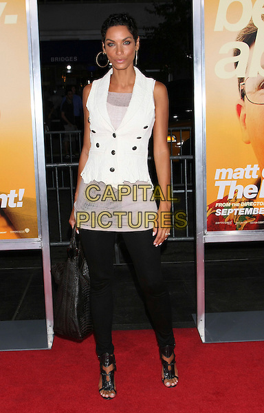 "NICOLE MURPHY .Attending the New York Premiere of ""The Informant!"", New York, NY, USA, .September 15th 2009..full length white sleeveless top waistcoat black leggings sandals open toe bag .CAP/LNC/TOM.©LNC/Capital Pictures."