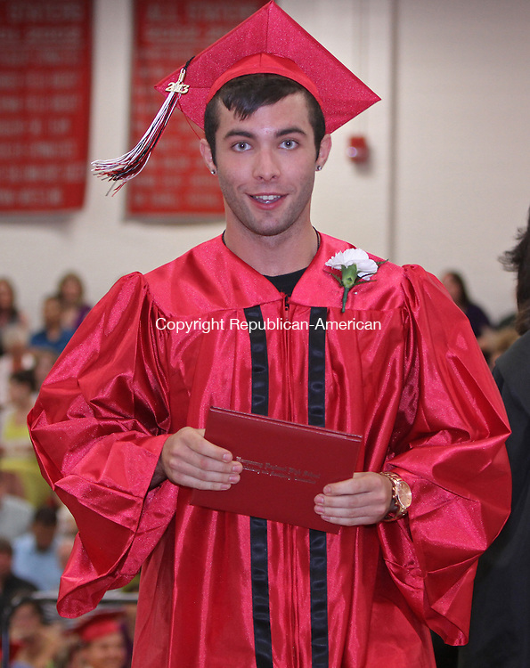 Southbury, CT-062113MK20 Graduate Ryan James Kennedy Torony walks off the stage with his new diploma during Pomperaug High School class of 2013 commencement exercises on Friday evening at Pomperaug High School in Southbury. Michael Kabelka / Republican-American.
