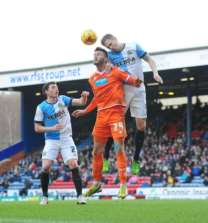 Blackburn Rovers' Matthew Kilgallon heads clear under pressure from Blackpool's Gary Madine<br /> <br /> Photographer Chris Vaughan/CameraSport<br /> <br /> Football - The Football League Sky Bet Championship - Blackburn Rovers v Blackpool - Saturday 21st February 2015 - Ewood Park - Blackburn<br /> <br /> &copy; CameraSport - 43 Linden Ave. Countesthorpe. Leicester. England. LE8 5PG - Tel: +44 (0) 116 277 4147 - admin@camerasport.com - www.camerasport.com