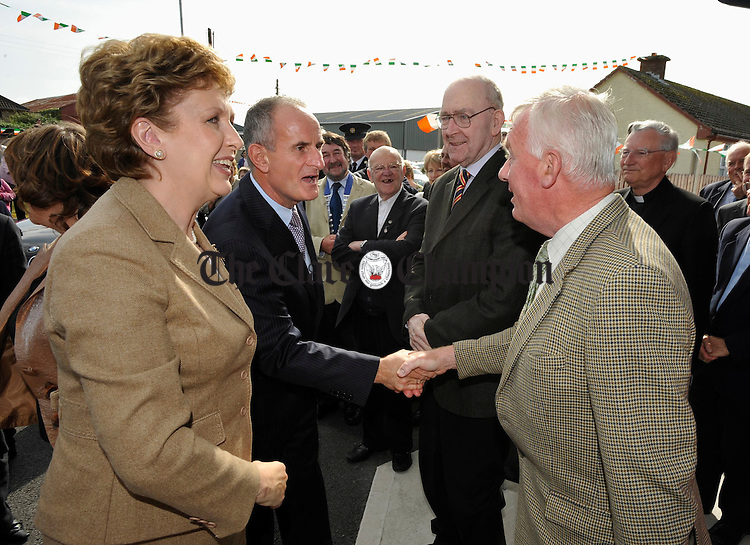 The president Mrs Mc Aleese and her husband Martin are greeted by councillor Christy Curtin and local man Michael Mahoney on their arrival for  the official opening of the Spraoi Family Resource Centre at Miltown Malbay. Photograph by John Kelly.