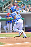 Tennessee Smokies right fielder Jeffery Baez (33) runs to first base during a game against the Mississippi Braves at Smokies Stadium on May 20, 2018 in Kodak, Tennessee. The Braves defeated the Smokies 7-4. (Tony Farlow/Four Seam Images)