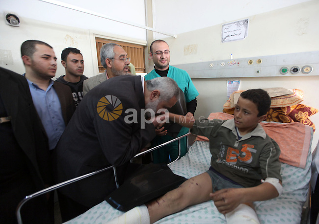 Palestinian Prime Minister in Gaza Strip, Ismail Haniyeh, visits a number of palestinians wounded of the Shifa hospital in Gaza City, on Mar. 13, 2012. Photo by Ahmed Shaat