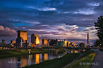Dayton Ohio skyline photo with glow of sunset. River view from Deeds Point