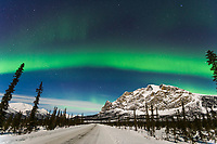 Aurora over the James Dalton Highway and mount Sukakpak in the Brooks Range, Arctic, Alaska