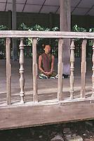 A worshipper in deep meditation at the Shwedagon Pagoda.