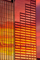 Picturesque view of the exterior of the US Bancorp tower and One Financial Center building with the colorful glow of sunset reflected in the windows. portland, Oregon.