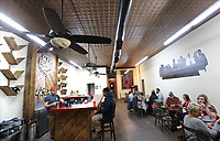 NWA Democrat-Gazette/DAVID GOTTSCHALK The interior of the new downtown taproom of the Fort Smith Brewing Company located at 115 N. 10th Street at Brunwick Place in downtown Fort Smith.