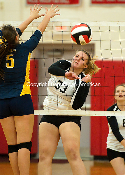 SOUTHBURY, CT--- -092815JS17---Pomperaig's Allie Ostar (33) spikes the ball past Weston's Amy Lautenslager (5) for a point during their match Monday at Pomperaug High School in Southbury. Pomperaug defeated Weston 3-2. Jim Shannon Republican-American